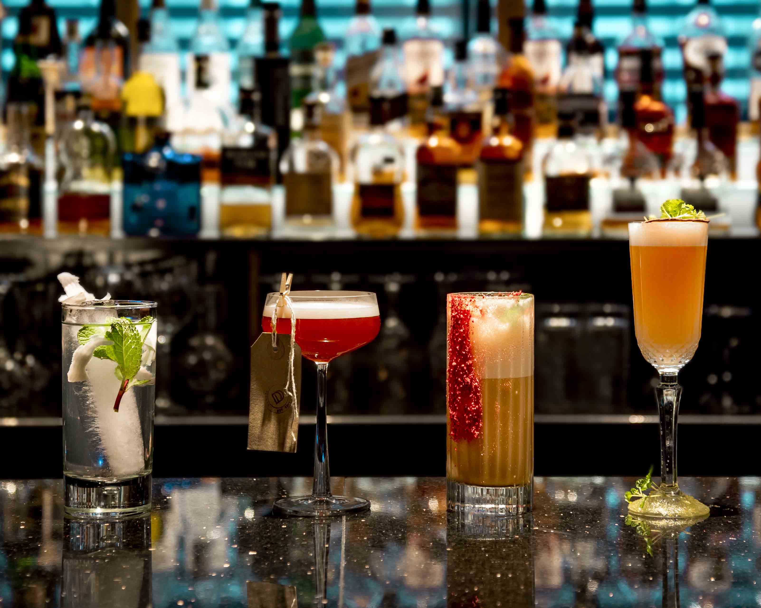 4 cocktails on a bar at the Dakota Hotel