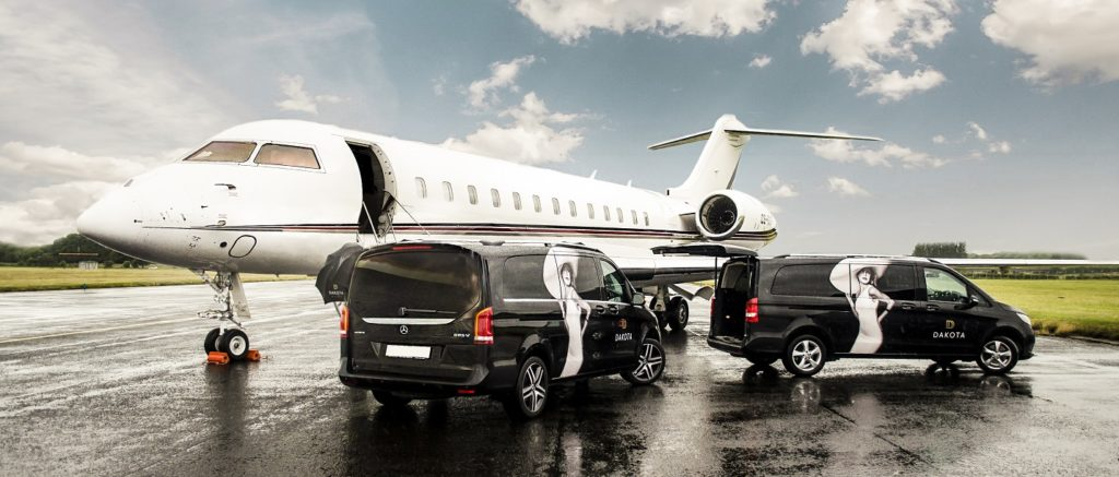 Private jet on runway with Dakota Hotel transport