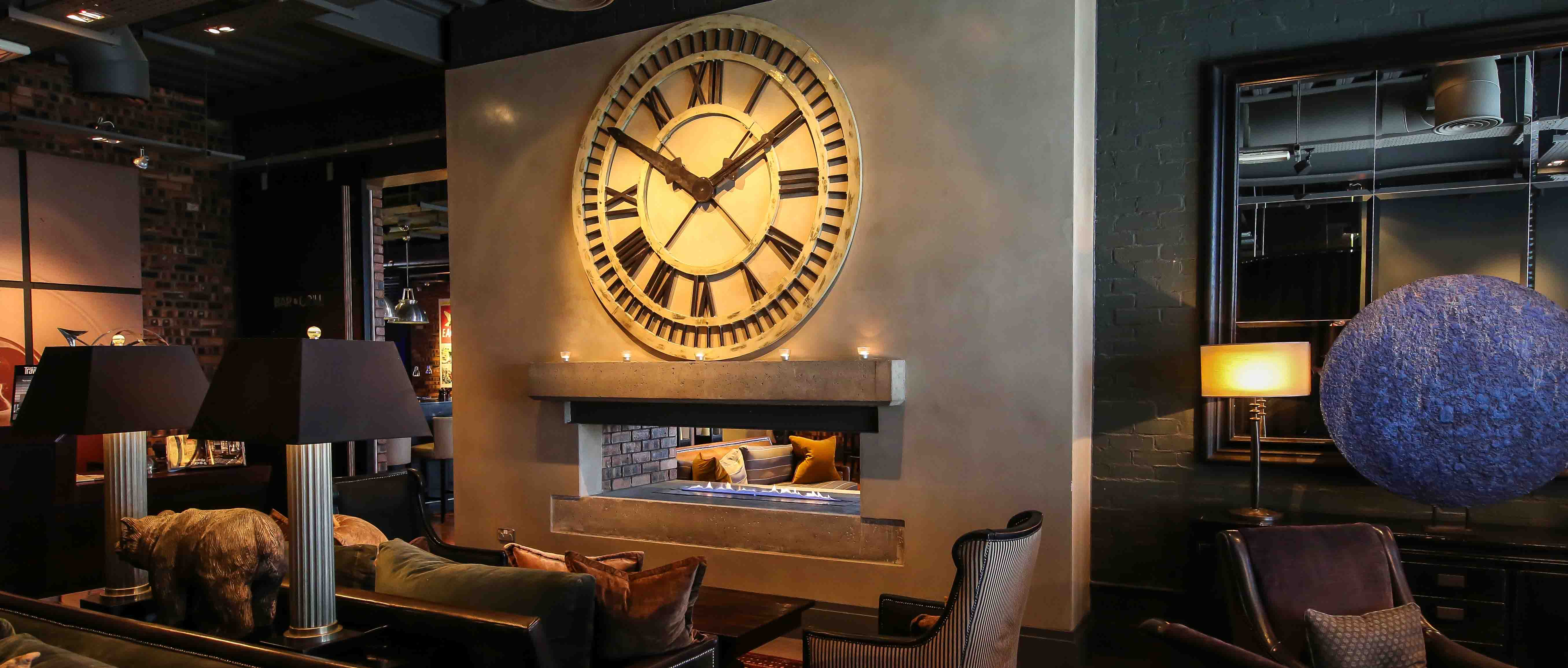Large clock above fireplace at Dakota Hotels