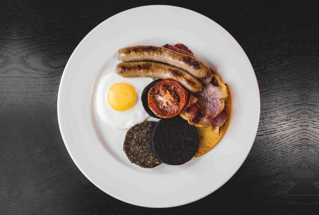 Dakota Glasgow - Cooked Breakfast - Fried egg, sausage, bacon, black pudding, tomato
